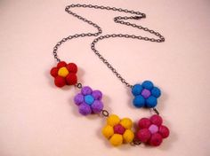 Felted Flower Necklace Colorful and Copper Beaded by QuiltsbyLisa, $17.00 https://www.etsy.com/listing/31960845/felted-flower-necklace-colorful-and