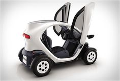 This is the Twizy, an affordable urban vehicle designed by Renault, with only two seats - motorbike style, with a passenger sitting behind the driver - very small, light and agile, perfect for city use.