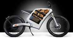 The Feddz electric cargo scooter trades the gas tank for storage space. Feddz has been designed and built by Germany's Emo-Bike. The Feddz uses an electric motor built into the hub of the wheel and that leaves a giant hole in the motorcycle's frame. This hole can be used for storage.