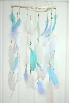 A color combination of light blue and medium blue feathers creates a beautiful look in this dreamy mobile. It features an all gemstone blue bead weave and blue stone and wooden beads. Suited for nurseries, playrooms, home decor or events, this modern take on the dreamcatcher will bring beauty and delight wherever it goes. This dreamcatcher comes to you handmade with love, detail and high quality components. From the natural willow ring found and formed in Montana, to a variety of beads and…