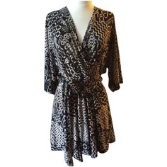 Veronica M Romper Veronica M Romper. Size XL. Worn only a few times. Has a few loose threads. See photos.  Black and Tan tribal print.  One piece shorts with pockets and tie. Veronica M Dresses Mini