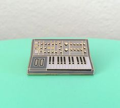 Synth Keyboard Enamel Pin by charmingafternoon on Etsy https://www.etsy.com/listing/267423146/synth-keyboard-enamel-pin