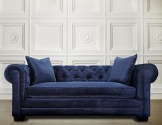 The uniquely beautiful Norwalk navy sofa adds comfort and plenty of style to any room. Entirely made by hand, this sofa features hand-applied nail heads, a kiln dried solid wood frame, eight-way hand- Cushions On Sofa, Leather Sofa, Navy Blue Sofa, Velvet Sofa, Tufted Sofa, Furniture, Sofa Pictures, Sofa, Navy Velvet Sofa