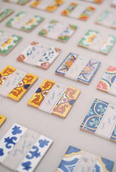Spanish tile escort cards for this Santa Barbara wedding