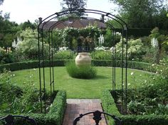 Formal circular garden with box hedging and roses