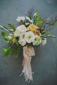garden roses, ranunculus, flowering jasmine, and greenery