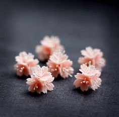 Pink Sakura Stud Earrings Handcrafted Polymer Clay Flowers by lagoaclaycreations on Etsy https://www.etsy.com/listing/228360612/pink-sakura-stud-earrings-handcrafted