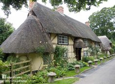 This is a re-purposed village. Many of the oak frame wattle & daub cottages in Wherwell, Hampshire, England were built in the early 16th century after Henry VIII disbanded Wherwell Abbey. You can see more cottages from the village at www.naturalhomes.org/wherwell.htm