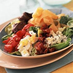 Midwest-Style Cobb Salad    Credit for the original Cobb salad goes to Bob Cobb at his Brown Derby Restaurant in Los Angeles back in the 1920s. We gave it a Heartland twist, with steak instead of chicken. Maytag blue cheese stands in for Roquefort. Use cantaloupe for the avocado, if you like.