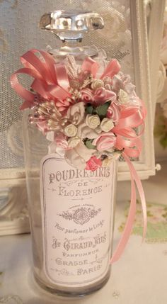 Items similar to Altered Bottle adorned in soft pink/white mini satin roses, vintage perfume label, lace, pink ribbons, pearl sprays on Etsy Bottle Box, Bottle Vase, Bottles And Jars, Glass Bottles, Perfume Bottles, Shabby Chic Crafts, Shabby Chic Pink, Shabby Chic Decor, Vintage Bottles