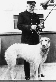 """Captain Smith and his dog on the Titanic-1912 """"Benjamin Guggenheim...knew him and his family well. [he] ended up on the Titanic, and brought a large Russian Wolfhound as a gift for the Captain's daughter. The day before sailing, Smith had his photo taken on board with the dog that he named 'Ben' in honor of the man who gifted him. The dog remained overnight, but was taken home to his daughter the next morning, so he was not on board when the ship got underway."""""""