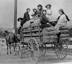 "Wagon trip home to Glendale from Pasadena, 1911. The back of the photograph reads, ""the girls had gone to a house party and it rained all the way home."" Ruth Williams Rifenbuish is sitting in the front with the black hat. Glendale Central Public Library. San Fernando Valley History Digital Library."
