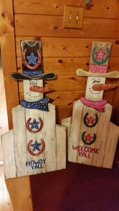 Cowboy and cowgirl snowmen on pallet board hand paintes
