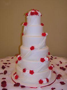 Roses and drapes wedding cake.
