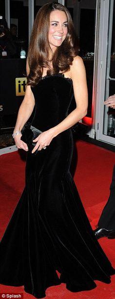 Incredibly beautiful woman in a fabulous black velvet dress.