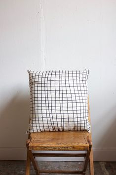 Grid print pillow made with organic cotton in small batches.