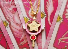 This+lovely+charm+is+based+off+of+the+Sakura+Star+key+necklace+Sakura+wears+from+the+anime+Cardcaptor+Sakura!+It's+even+to+scale+with+the+original+so+you+can+wear+it+with+daily+wear+or+if+you+would+like+to+cosplay+~+♪。+。  It+is+made+from+layers+of+gold+colour+acrylic+with+carefully+engraved+det...