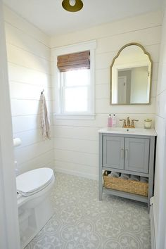 First floor bathroom (powder room) renovation that includes gray and gold tones, shiplap walls as well as a beautiful cement tile installation.