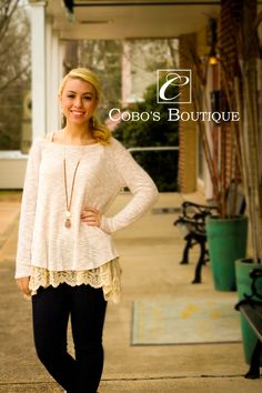 Try this cute light weight sweater with one of our laced bottom tanks :)