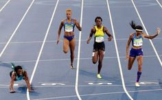 Shaunae Miller of the Bahamas dives to win the gold medal in the women