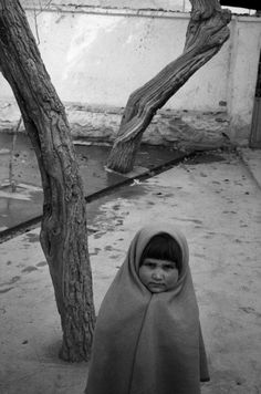 abbas(1944- ), afghanistan. city of kabul. 2001. little girl in a courtyard.