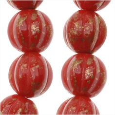 CZECH PRESSED GLASS ROUND MELON BEADS 8MM OPAQUE REDMARBLED GOLD 25 from beadaholique.com