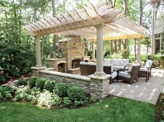 Outdoor living: pergola covered patio with fireplace. Beautiful backyard!