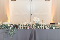 Mr. and Mrs. Head Table decor -  Design by: Feathered Arrow    Flowers by: Poppyhill Flowers    Photo By: Sun & Sparrow