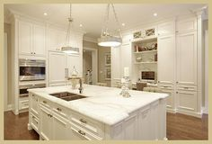 modern white kitchen with built in appliances