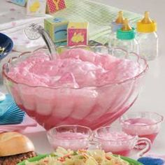 Rock-A-Bye Baby Punch Pink Baby Shower Punch - 3 quarts of raspberry sherbet and 6 liters of ginger ale (chilled). Just before serving, place sherbet in a punch bowl. Add ginger ale and stir until sherbet is almost melted. Party Drinks, Fun Drinks, Yummy Drinks, Beverages, Cocktails, Refreshing Drinks, Alcoholic Drinks, Fruity Drinks, Frozen Drinks