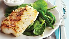 Greek-Style Grilled Fish with Cucumber Mint Yogurt. Grilled oregano-kissed cod fillets are paired with a classic tzatziki sauce for a fresh and tasty meal with just 134 calories per serving. Serve fish on a bed of greens if you have some on hand.