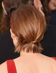 If you don't quite have enough hair for a ponytail, try this instead. Pull the longest strands from an asym...