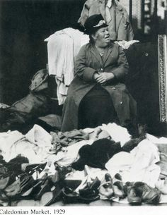 this photo was taken in 1929 and poverty, for some, was rife. I think this lady probably collected clothes etc to sell in hope of making what money she could