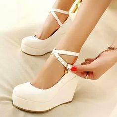 Mary jane high wedge with 2 ankle straps. Avail in white brown and black