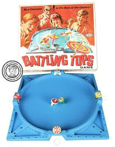 Battling tops.  Had this too!   The black top was especially good so we fought over it.  Such fun