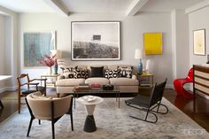 """While surfing the Internet, they noticed a listing for a three-bedroom unit in London Terrace, a 1930s apartment complex that encompasses an entire city block near the High Line. """"I love the bones of that building—the old black-and-white bathrooms, the beamed ceilings and paneled doors,"""" Greenhill says. """"Cool people live there, like Debbie Harry. And there are hardly any three-bedroom apartments available. It was like a golden ticket."""" The George Smith sofa in the living room is covered in a…"""