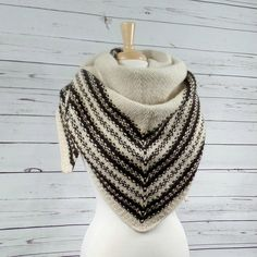 Voyageur is a triangle shawl knit from the top down, a perfect winter accessory to keep you warm. Find this pattern and more knitting inspiration at LoveKnitting.Com.