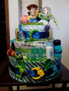 Toystory diaper cake Disney Diaper Cake, Diaper Cake Boy, Baby Boy Cakes, Diaper Cakes, Navy Baby Showers, Boy Baby Shower Themes, Baby Boy Shower, Baby Shower Decorations, Toy Story Baby