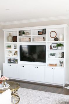These white built-ins in this blush family room have lots of storage and room fo. These white built-ins in this blush family room have lots of storage and room for accessories Living Room Built Ins, Living Room Wall Units, Design Living Room, Living Room Cabinets, Home Living Room, Family Room Design With Tv, Storage In Living Room, Bookcase In Living Room, Living Room Decor With Tv