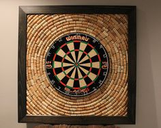 THIS IS A SPECIAL ORDER ITEM AND WILL TAKE APPROXIMATELY 3 WEEKS FROM TIME ORDER IS PLACED TO SHIPMENT. This particular dartboard backer with an accompanying scoreboard and dart storage has been sold but is an example of something I can create for your man cave, bar or game room. The piece shown here was made with hundreds of authentic wine corks (zero fabricated corks) which are adhered to a wood backer board. The frame is handmade and can be finished to your liking -- stain, color…