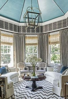 Lovely sitting room with light turquoise ceiling
