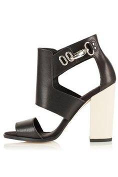 Nice graphic sandal, love the colorblock heel and modern shape. Topshop- Richard Hi-Vamp Sandals.
