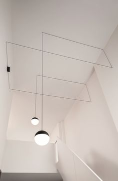 "String Lights by Flos Nederland ""a black electric wire that sets up a relationship with the architecture of a space, precisely becoming part of the lines formed by the walls of a room."""