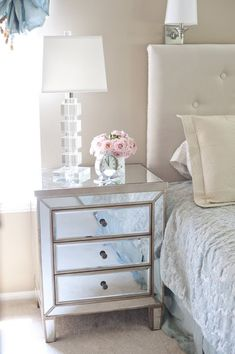 Mirrored glass side tables give bedrooms a glamorous feel.