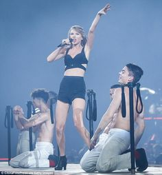 Stage queen: Taylor gave a rousing performance with the help of a male dance troupe...