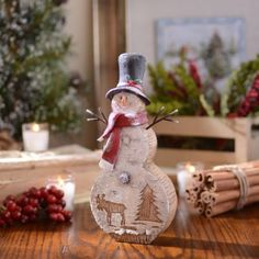 Rustic Nature Snowman Statue | Kirklands-This on even better
