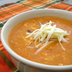 Chicken Enchilada Soup -Real Mom Kitchen.  Ok so made this tonight -Oct 13:) sooo super!!! I did cream of corn instead of frozen - just like reviewers suggested & 1/2 of regular canned corn (we love corn) we topped it off w/ avocado & a dollop of sour cream w/ crushed tostito's chips.  Have enough to reheat for the two of us again another two meals. Would be excellent w/ jalapeño cornbread mix! This is a winner.
