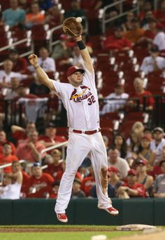 St. Louis Cardinals first baseman Matt Adams leaps for an errant throw by pitcher Randy Choate as Arizona Diamondbacks Ender Inciarte reache...