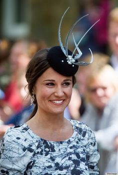 The much anticipated Alnwick society wedding, which royal favorites Prince William and Prince Harry also attended, offered an occasion for Pippa to pick an ambitious peplum dress in a black and white print. Clearly not yet ready to abandon Royal Ascot fashion, Pippa paired the party frock with a dramatic fascinator.