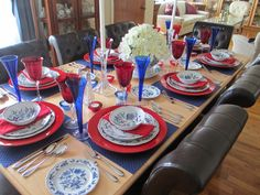 Sometimes it's hard to pull off a thematic tablescape without it looking childish or overdone.  This patriotic setting is beautiful and pleasing.  There are no overtly patriotic designs, such as stars or flags, and the dishes and glasses are rich and attractive.